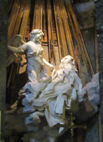 "At the church of Santa Maria della Vittoria in Rome, St. Teresa of Avila is depicted in marble by Gian Lorenzo Bernini in The Ecstasy of Saint Teresa. Completed in 1652, the sculpture depicts the mystic's vision of being pierced by an angel's arrow. ""So surpassing was the sweetness of this excessive pain, that I could not wish to be rid of it,"" she wrote in her autobiography. (CNS photo/Mike Nelson)"