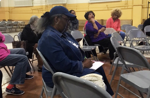 "Participants in the session ""Racism and Prejudice in Our Parishes"" take notes for discussion in the final part of this year's series, ""Conversations on Race in Our Country,"" held May 22 at St. Athanasius Parish, Philadelphia."