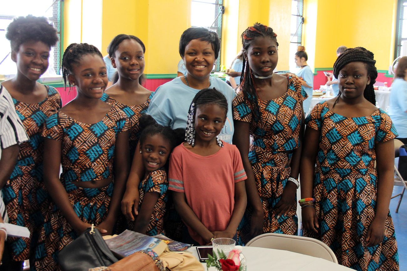 The American-born children of Liberian refugees proudly pose together June 20 at the Family Service Center of Catholic Social Services on June 20.
