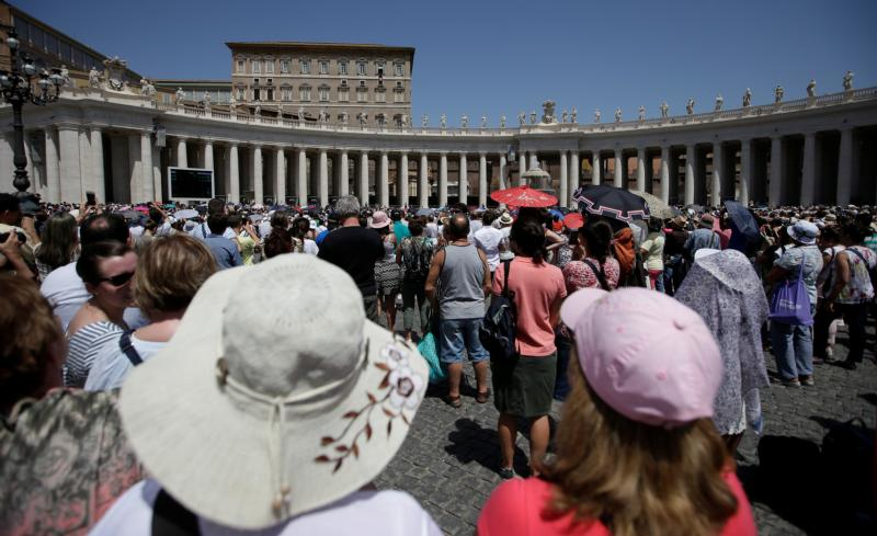 Pilgrims listen as Pope Francis leads the Angelus July 9 in St. Peter's Square at the Vatican. (CNS photo/Max Rossi, Reuters)