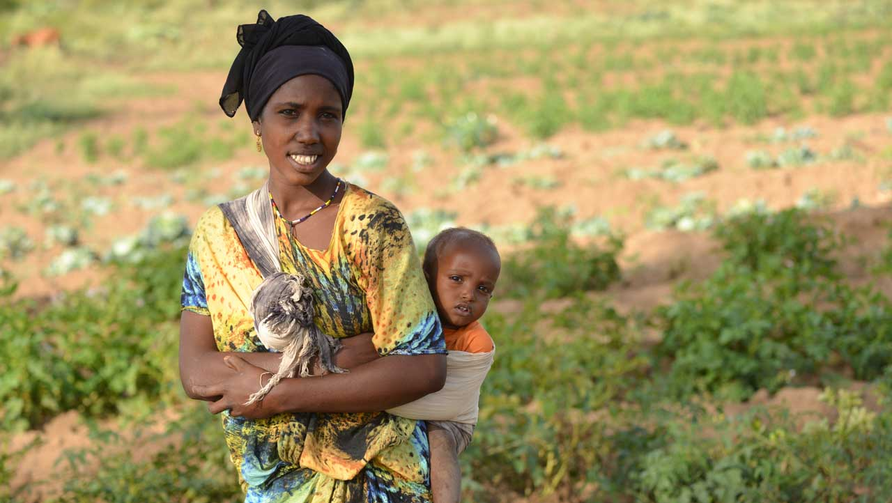 Anisa Gourate and her son, Muhammad, pose in 2015 on their farm near Jijiga, Ethiopia. With support from the Canadian Catholic Organization for Development and Peace the Gourate family has a livelihood that will support their healthy young family. Canada and other donor nations are proposing legal abortion in African nations as part of their overseas development aid programs. (CNS photo/Michael Swan, Catholic Register)