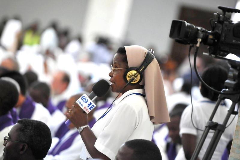 A woman religious is seen with TV crew at St. Paul Church in Luanda, Angola, in this 2009 file photo. (CNS photo/Ciro Fusco, EPA)