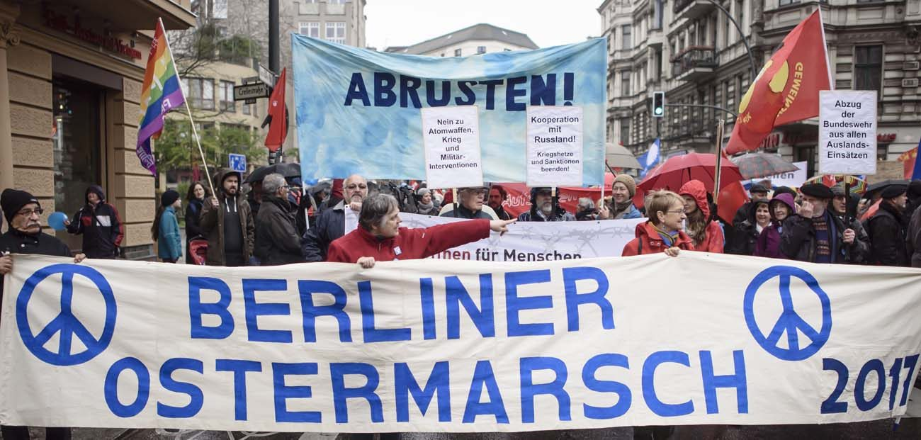 A group marching for nuclear disarmament carries a banner during a protest in mid-April in Berlin. Agencies of the U.S. and European Catholic bishops have called for all nations to develop a plan to eliminate nuclear weapons from their military arsenals. (CNS photo/Clemens Bilan, EPA)