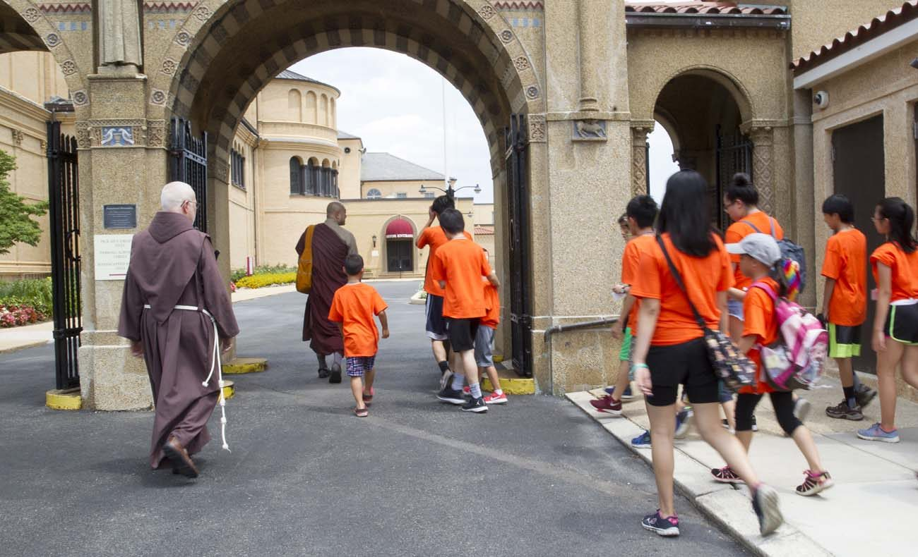 Venerable Sagarananda Tien and Father James Gardiner, a Franciscan Friar of the Atonement, walk with children from the U.S. Zen Institute summer camp July 12 to the Franciscan Monastery of the Holy Land in Washington. The Buddhist children spent the afternoon learning about Christianity, St. Francis and the Franciscans as way to understand other traditions and cultures, said Tien. (CNS photo/Rhina Guidos)