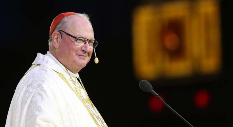 """Cardinal Timothy M. Dolan of New York smiles as he delivers the homily during the opening Mass of the """"Convocation of Catholic Leaders: The Joy of the Gospel in America"""" July 1 in Orlando, Fla. Leaders from dioceses and various Catholic organizations are gathering for the July 1-4 convocation. (CNS photo/Bob Roller)"""