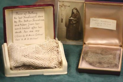 The Rosemont College archives hold several artifacts from Venerable Cornelia Connolly, including a portion of the last needlework she created (left) and a lock of her hair. (Sarah Webb)