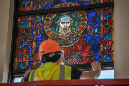 One of 45 restored windows from the former Ascension of Our Lord Church, a parish in Philadelphia's Kensington section that closed in 2012, is installed in the Holy Name of Jesus Cathedral in Raleigh in March 2017. (Courtesy of the Catholic Diocese of Raleigh)