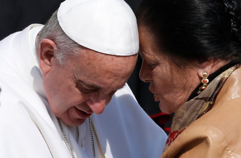 Pope Francis listens to a woman during his March 11 general audience in St. Peter's Square at the Vatican. Effective evangelizing for ordinary Catholics means keeping it simple: Listen first. Then talk. (CNS photo/Paul Haring)