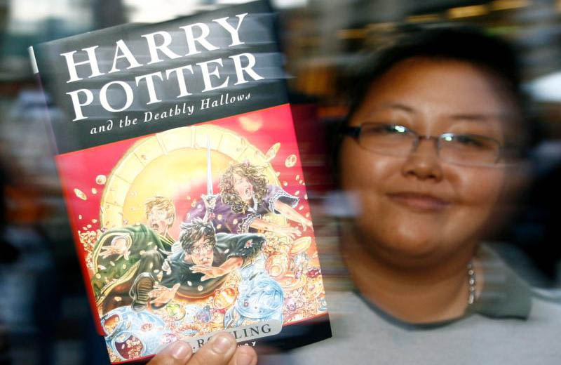 "A woman displays the last of a series of seven Harry Potter books by British author J.K. Rowling titled ""Harry Potter and the Deathly Hallows,"" in 2007 in Bangkok. June 26 was a day to remember for Harry Potter fans old and new as it marked 20 years since the iconic ""Harry Potter and the Philosopher's Stone"" was first published. (CNS photo/narong Sangnak, EPA)"