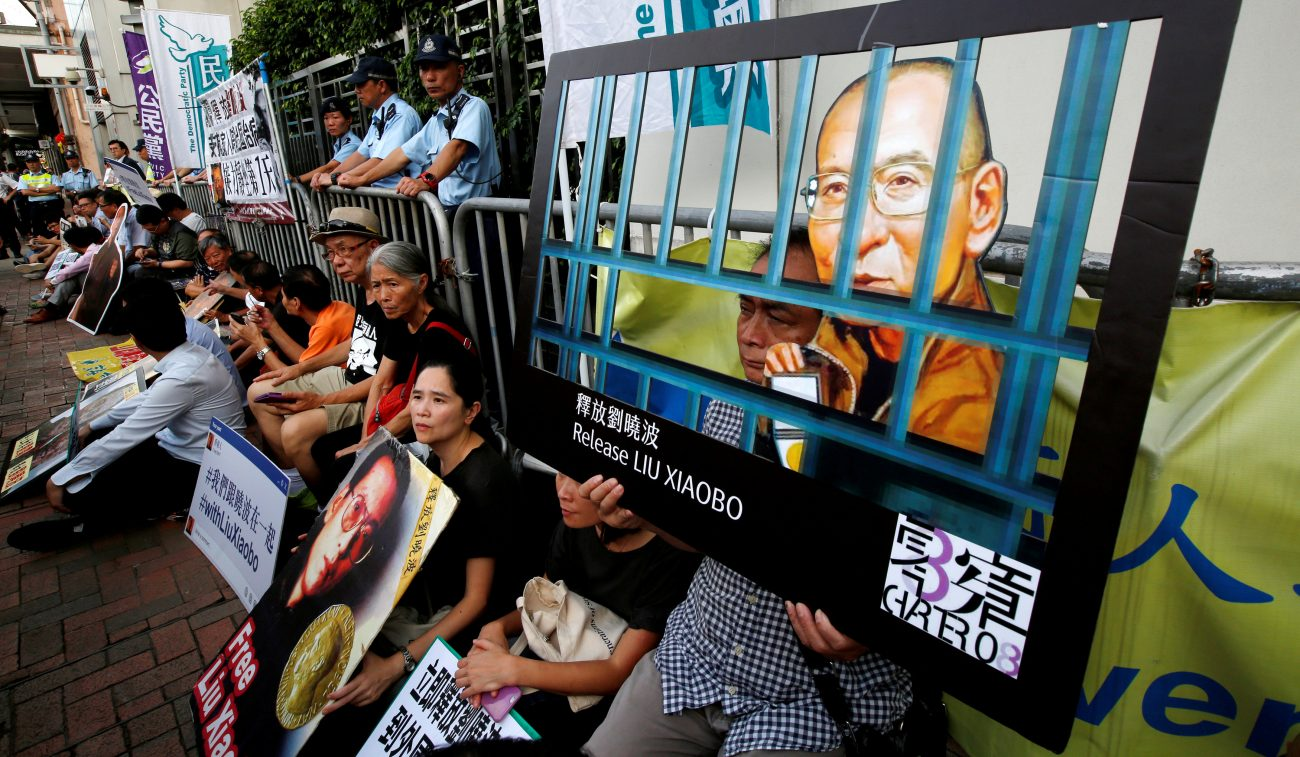 Activists stage a sit-in demanding the release of Liu Xiaobo, the 2010 Nobel Peace Prize winner, July 10 outside China's Liaison Office in Hong Kong. Hong Kong Christians came together to pray for terminally ill Liu, who was recently released from a Chinese prison but still remains on the mainland. (CNS photo/Bobby Yip, Reuters)
