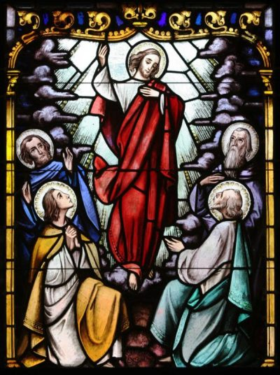 "Christ's ascent to heaven is depicted in a stained-glass window at St. Therese of Lisieux Church in Montauk, N.Y. In John's Gospel, Jesus says, ""In my Father's house there are many dwelling places. If there were not, would I have told you that I am going to prepare a place for you?"" (14:2). (CNS photo/Gregory A. Shemitz, Long Island Catholic)"