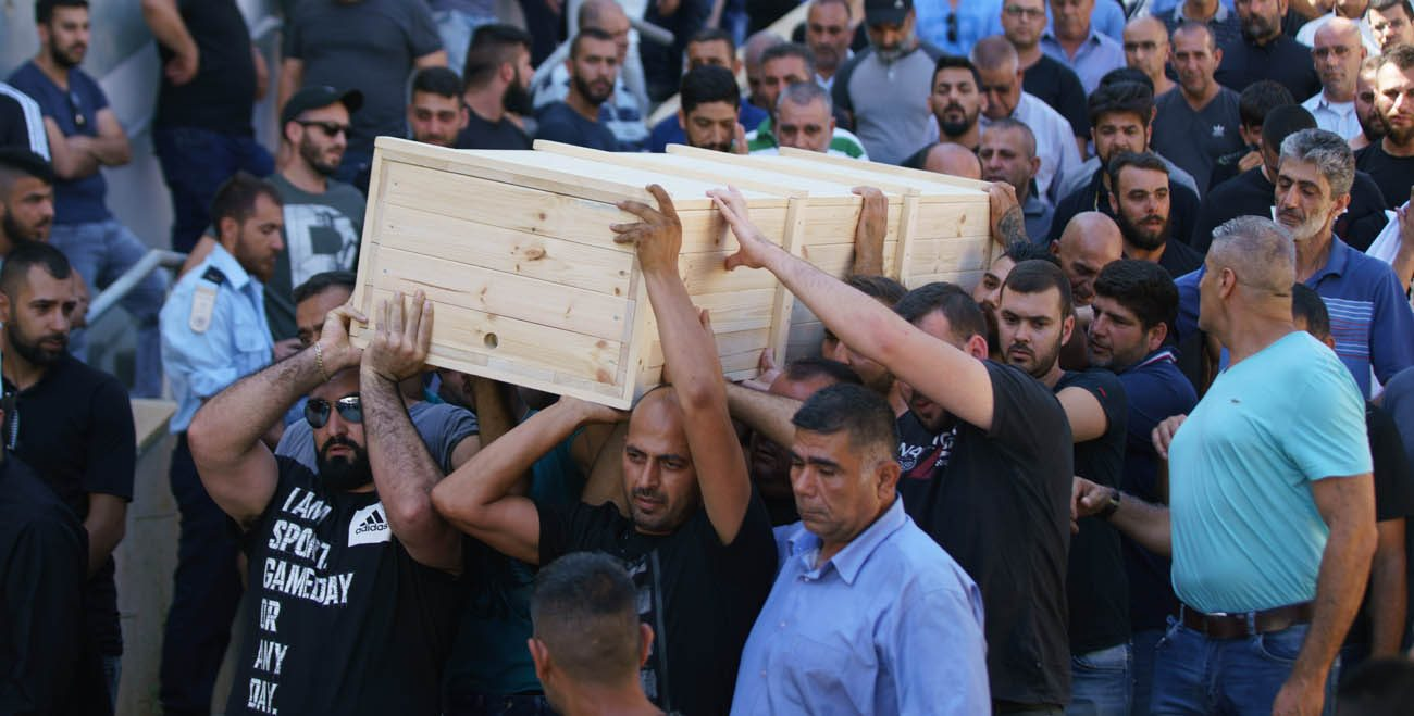 Men carry the casket of Israeli policeman Hail Sethawi July 14 who was killed in an attack at the Temple Mount compound in the Old City of Jerusalem. The deadly attack took place in the early morning hours near the Lions' Gate in the Old City walls, next to what Muslims call the Noble Sanctuary and Jews call the Temple Mount. (CNS photo/Ancho Gosh, EPA)