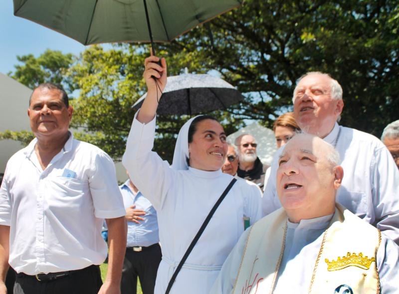 Franciscan Father Flavian Mucci, far right, celebrates 50 years of arriving in El Salvador July 9 in Sonsonate, El Salvador. In his 50 years in the country, Boston native Father Mucci has built an empire of social and public services that benefit the country's poor called the Agape Association of El Salvador. (CNS photo/courtesy of Agape Association of El Salvador)