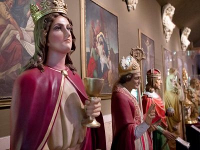 A statue of St. Barbara is flanked by other saints in the Museum of Divine Statues in Lakewood, Ohio.  (CNS photo/Dennis Sadowski)