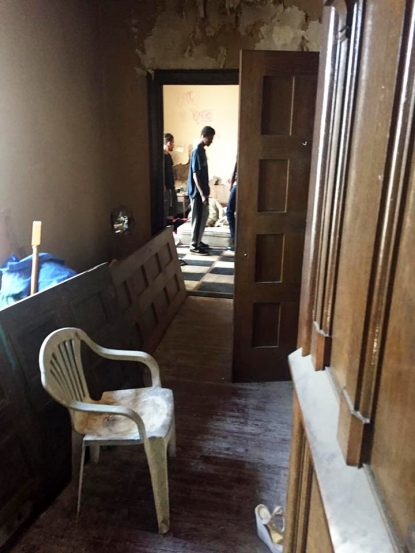 People walk through rooms in the former Ascension of Our Lord Church, which was closed in 2012 and sold in 2014.