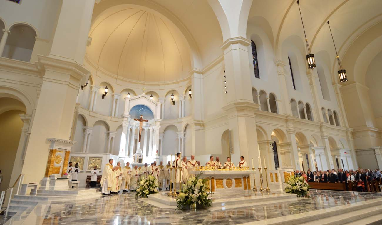 Bishop Michael F. Burbidge of Arlington, Va., former bishop of Raleigh, N.C., concelebrates Mass July 26 at the dedication for Holy Name of Jesus Cathedral in Raleigh. (CNS photo/J. Eric Braun, courtesy Diocese of Raleigh) See RALEIGH-CATHEDRAL-DEDICATION July 28, 2017.