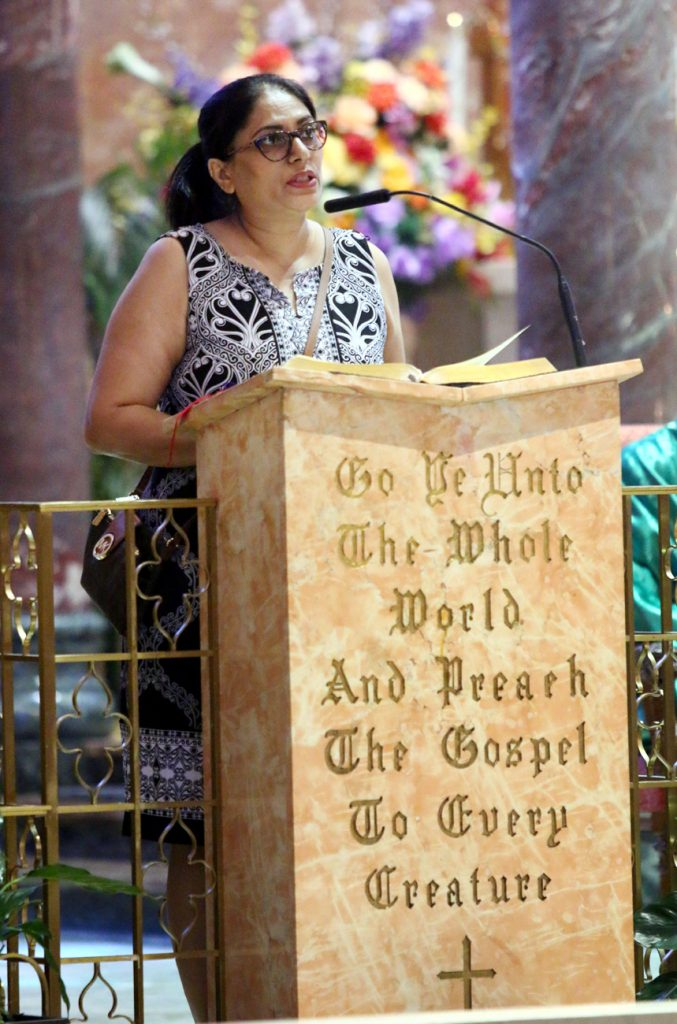 Lector Sajida Karamat proclaims the readings at Resurrection of Our Lord Church on Sunday, July 9.