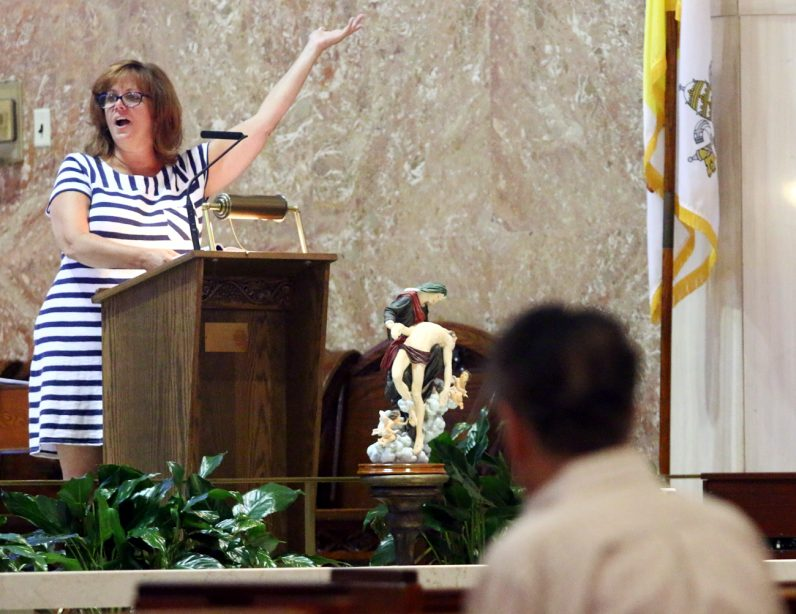 Cantor Laura Puma fills the church with her voice.