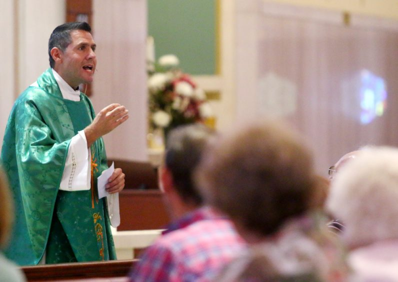 Father Jim DeGrassa, pastor, preaches his homily at Resurrection of Our Lord Church.