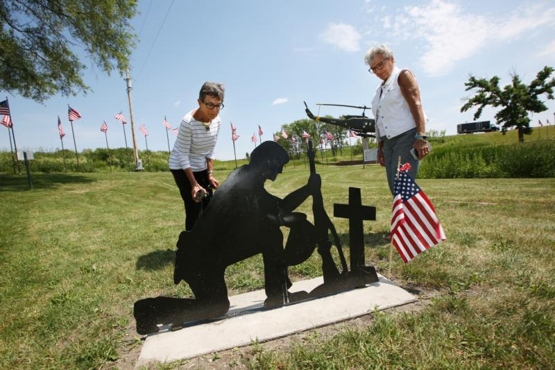 Sisters Shirley Citrowski and Carol Speich pause to look at a monument of a soldier at Veterans Memorial Park in Belle Plaine, Minn., June 9. A proposed monument that Massachusetts-based Satanic Temple wants to install in the park has roiled some members of the community, including the two women religious, who were born and raised in Belle Plaine but now live elsewhere. (CNS photo/Dave Hrbacek, The Catholic Spirit)