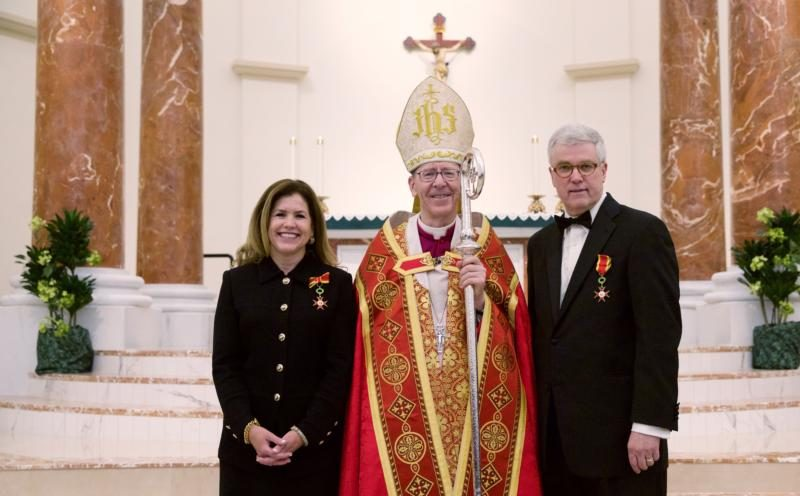 Phoenix Bishop Thomas J. Olmsted poses with Alan and Paula Sears June 29 after the Arizona couple received medals of the Order of St. Gregory the Great at St. Bernadette Church. (CNS photo/courtesy Bruce Ellefson, ADF)