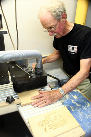 Jim Creighton, a member of Sts. Peter and Paul Church in Hopkinsville, Ky., and a member of the parish's Eclipse Committee, owns a woodworking shop and was busy in late June carving specially designed plaques in advance of the Aug. 21 solar eclipse. (CNS photo/courtesy Jim Creighton)