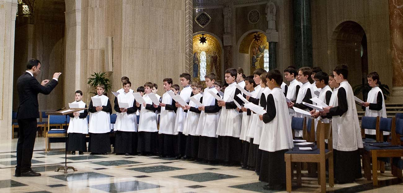 Members of the Escolania de Montserrat, one of the oldest and most venerable boys' choirs in Europe, perform at the Basilica of the National Shrine of the Immaculate Conception in Washington July 2. Founded in the 13th century, the choir sings daily for pilgrims at the abbey of Santa Maria de Monserrat in Catalonia, Spain. (CNS photo/Tyler Orsburn)