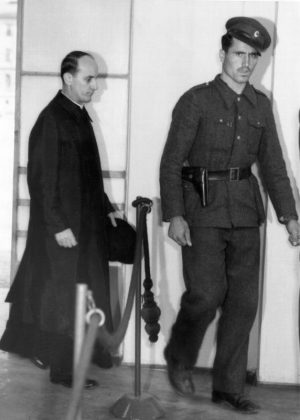Blessed Alojzije Stepinac enters a Zagreb courtroom in 1946. A commission of Croatian and Serbian experts studying Cardinal Stepinac's life said they were unable to reach a conclusion on questions regarding the controversial martyr's history. (CNS file photo)