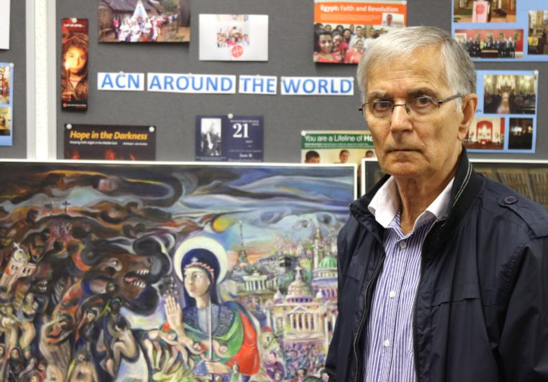 Farid Georges, a Syriac Christian from Homs, Syria, poses for a photo in England June 23. His artwork depicting Syria's six-year war is being shown in Catholic cathedrals of northwest England and Wales. (CNS photo/Simon Caldwell)