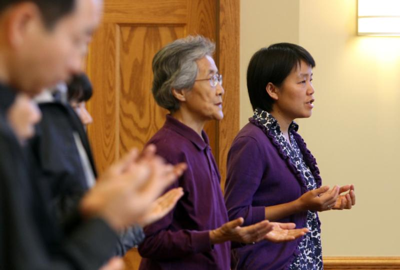 Johanna Chao, a Catholic spiritual director from Hanyang, China, second from right, and Sister Clara Zhang Jin Ping, right, a member of the Sisters of the Blessed Virgin Mary, recite the Lord's Prayer during Mass at the Cenacle Retreat Center in Ronkonkoma, N.Y., Aug. 20, 2014. A spiritual director helps us see and listen and move forward. (CNS photo/Gregory A. Shemitz)