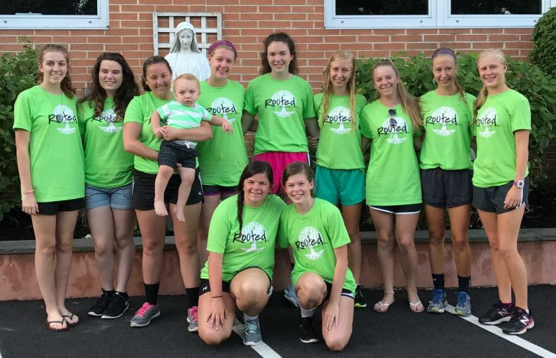 Members of the St. Pius X CYO group attended a Catholic Heart Work Camp in Massachusetts from July 2 to Jul7 8, 2017. The group was led by moderator Cindy Honyara (third from left, with infant).