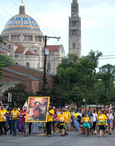 World Youth Day Unite participants march near Washington's Basilica of the National Shrine of the Immaculate Conception July 22. More than 1,300 young adults from across the country gathered in the nation's capital for the event designed to bring young people together to celebrate their faith in years when there is no global World Youth Day. (CNS photo/courtesy Daphne Stubbolo, Archdiocese of Washington) .