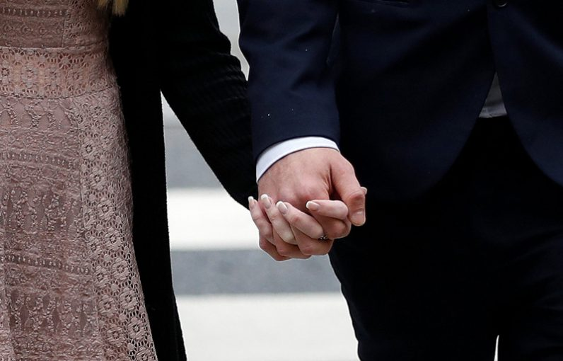 Connie Yates and Chris Gard hold hands as they arrive at the High Court in London July 24. Pope Francis is praying for the parents of Charlie Gard after a U.S. doctor told them nothing could be done to help their son who suffers from encephalomyopathic mitochondrial DNA depletion syndrome. (CNS photo/Peter Nicholls, Reuters)
