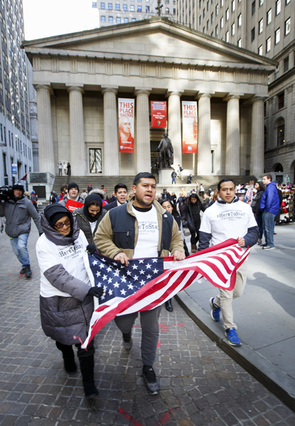 "Immigration advocates rally in New York City Nov. 22, 2016. The U.S. bishops' migration committee chair in a July 18 statement urged President Donald Trump to ""ensure permanent protection"" for youth under the Deferred Action for Childhood Arrivals program, or DACA. (CNS photo/Justin Lane, EPA)"