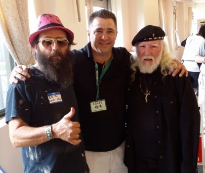 Mark Kolesar (center) of St. Thomas Aquinas Parish in Croydon, the event organizer, spends time July 29 with conference attendees Jack (right) and Ed, both of the Last Stop Recovery House in Philadelphia's Kensington section.