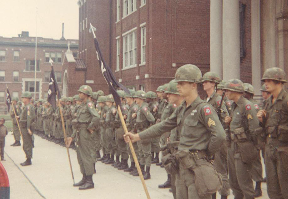 National Guard and Army troops from the 82nd Airborne Division stand at attention outside St. Rose of Lima Church on Detroit's east side during the 1967 Detroit uprising. Fifty years later, the effects of 1967 still loom large as the church and city seek to heal the wounds of the past. (CNS photo/Archdiocese of Detroit Archives)