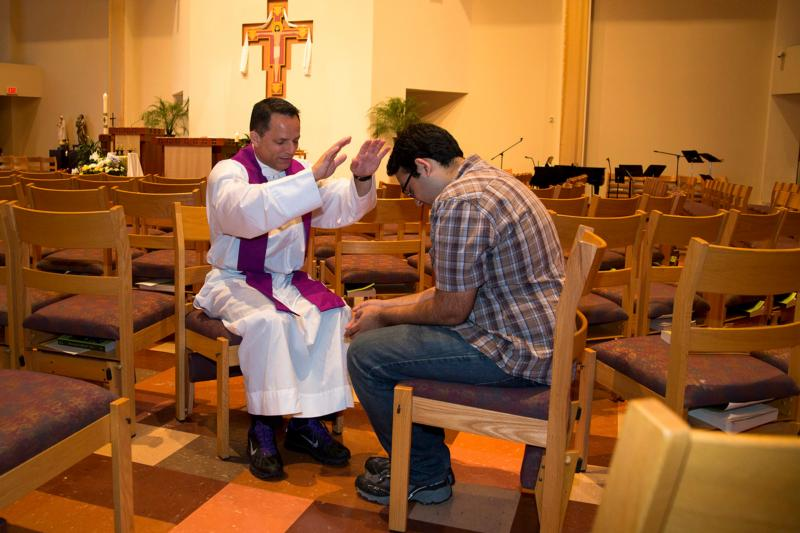 A priest blesses a FOCUS student in 2015 at a church on the campus of University of Texas at Austin at the University Catholic Center. Founded in 1998, the Fellowship of Catholic University Students, or FOCUS, will have 660 missionaries in teams of two women and two men on 137 college campuses for the 2017-2018 academic year. (CNS photo/courtesy FOCUS)