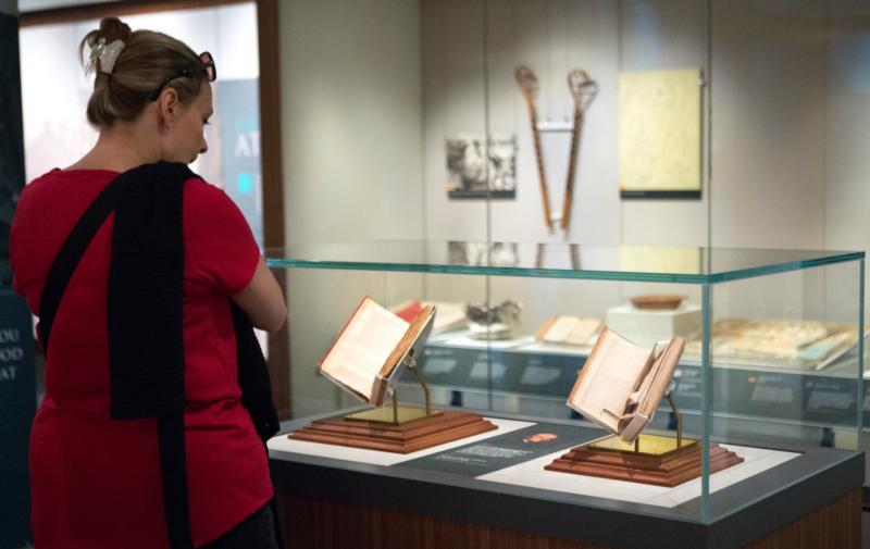 "A visitor at the Smithsonian Institution's National Museum of American History in Washington looks at items in the exhibit ""Religion in Early America"" July 26. The exhibit will be on display until June 3, 2018. (CNS photo/Chaz Muth)"