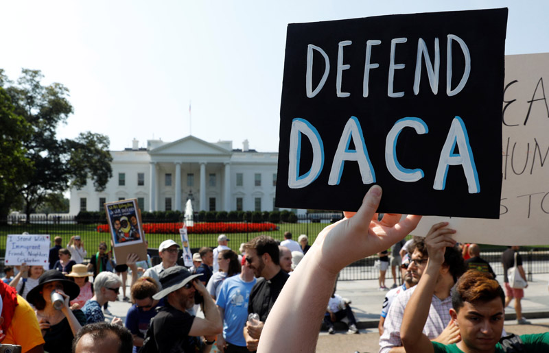 """Deferred Action for Childhood Arrivals supporters demonstrate near the White House in Washington Sept. 5. Attorney General Jeff Sessions announced Sept. 5 that the DACA program is """"being rescinded"""" by President Donald Trump, leaving some 800,000 youth, brought illegally to the U.S. as minors, in peril of deportation and of losing permits that allow them to work. (CNS photo/Kevin Lamarque, Reuters)"""
