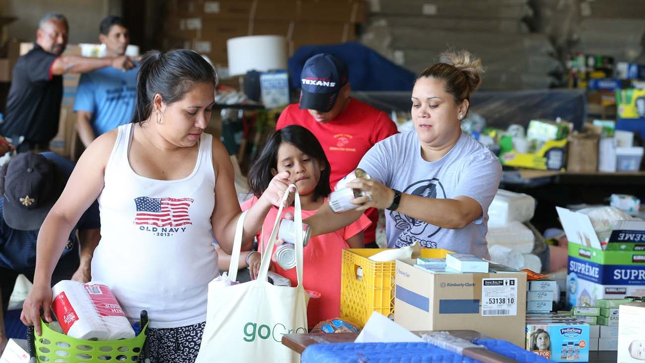 An Employee At Gallery Furniture Provides Relief Goods To Victims In The  Aftermath Of Tropical Storm Harvey Sept. 7 In Houston. Store Owner Jim  McIngvale, ...