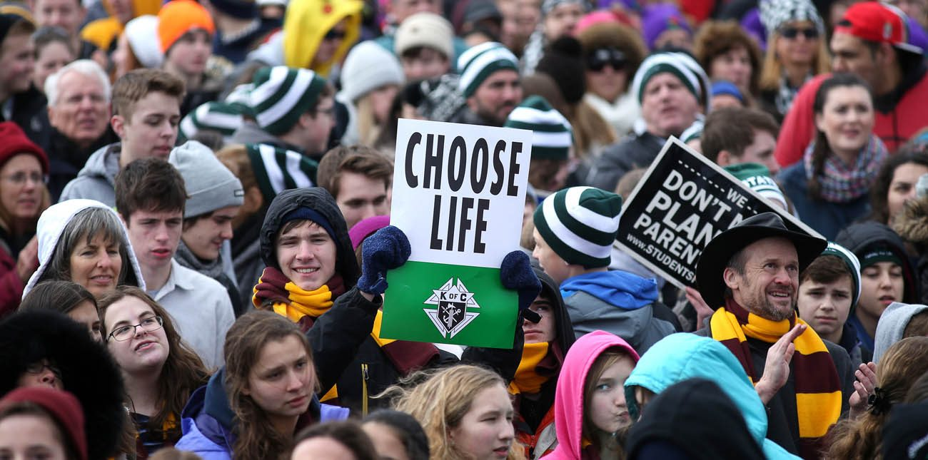 "Pro-life advocates attend the annual March for Life in Washington in this Jan. 27, 2017, file photo. ""Love Saves Lives"" will be the theme for the 2018 March for Life Jan. 19. (CNS photo/Tyler Orsburn)"