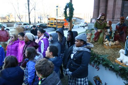 students from st francis xavier school sing a christmas song at the nativity creche blessing dec 13 on 18th street and benjamin franklin parkway