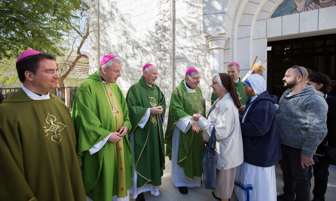 Visiting bishops praise gazans but say christian presence is bishop oscar cantu of las cruces nm far left waits to greet people after concelebrating mass jan 14 at holy family parish in the gaza strip kristyandbryce Image collections