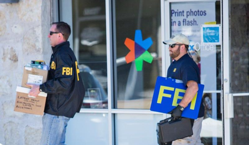 fbi agents are seen carrying items out in paper bags and boxes march 20 from a fedex store in austin texas after a fifth bombing