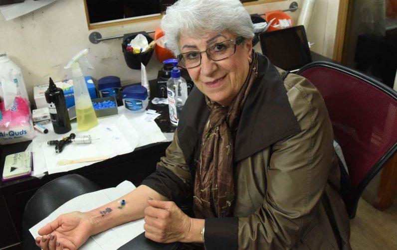 christian pilgrims to holy land get tattoos to mark their