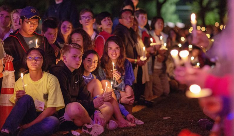 Teens enjoy prayers by candlelight at AbbeyFest on the grounds of Daylesford Abbey, Paoli. (Photo by Michelle Kilgore)