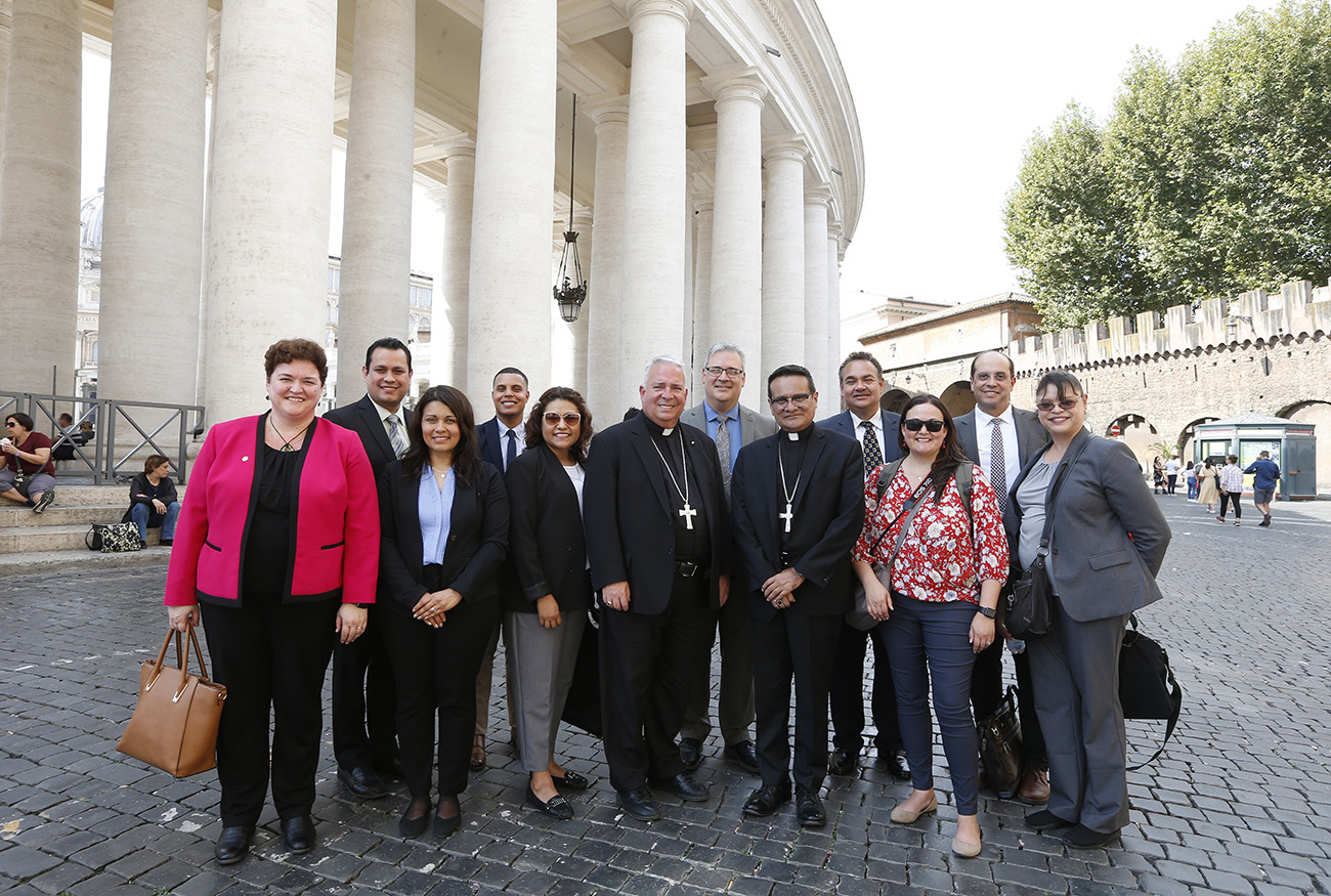 Bishop Nelson J. Perez of Cleveland and Auxiliary Bishop Arturo Cepeda of Detroit are pictured with Encuentro representatives from the United States near the Vatican Sept. 16, 2019. The group was in Rome to present findings from the Fifth National Encuentro to Pope Francis and Vatican officials. (CNS photo/Paul Haring) See VATICAN-GOMEZ-BISHOPS-ENCUENTRO Sept. 17, 2019