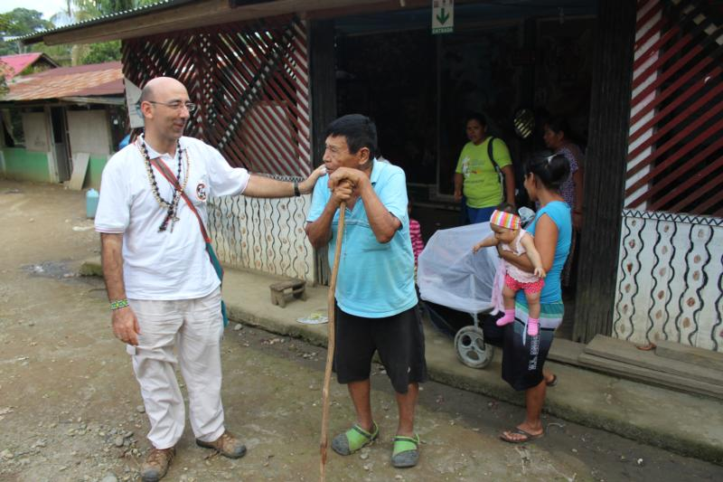 "Bishop David Martinez De Aguirre Guinea, apostolic vicar of Puerto Maldonado, Peru, chats with a man from the indigenous community of Arazaire Feb. 20, 2018. The Synod of Bishops for the Amazon will take place at a time when ""both human and natural life are suffering serious and perhaps irreversible destruction,"" Bishop Martinez said in a Sept. 12, 2019, article. (CNS photo/stringer)"