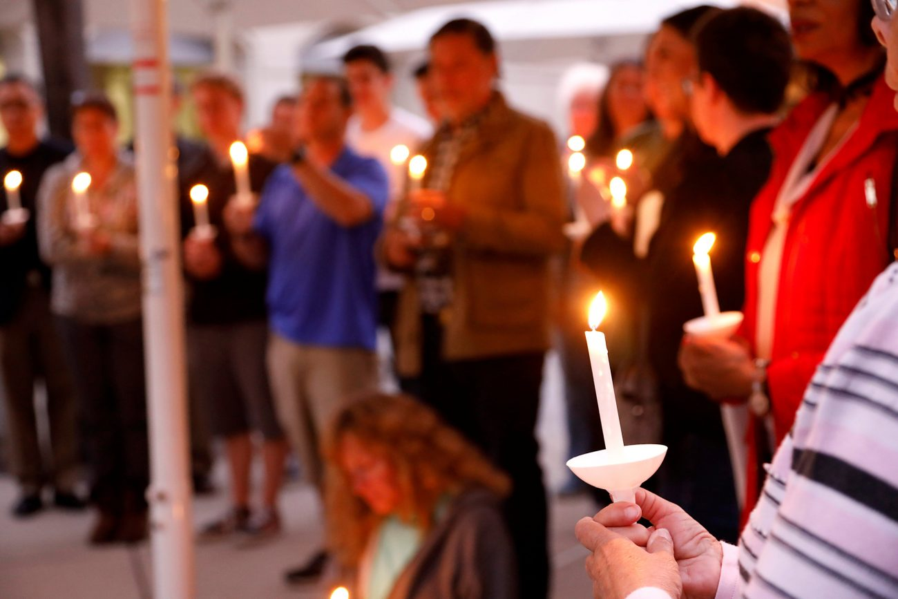 """A candlelight vigil is held April 27, 2019, at Rancho Bernardo Community Presbyterian Church for victims of a shooting incident at the Congregation Chabad synagogue in Poway, Calif., near San Diego. In response to the shooting, Cardinal Daniel N. DiNardo of Galveston-Houston and president of the U.S. Conference of Catholic Bishops, said in an April 28 statement: """"Our country should be better than this; our world should be beyond such acts of hatred and anti-Semitism."""" (CNS photo/John Gastaldo, Reuters) See story to come."""
